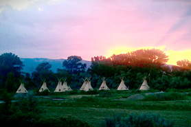 Teepees lined up at the Turtle Tracks Riverfront Resort