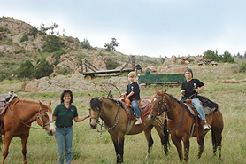 Lady leading horses on a Guided Trail Ride with Western Ridge Resort & Restaraunt in the Red Feather Lakes Area