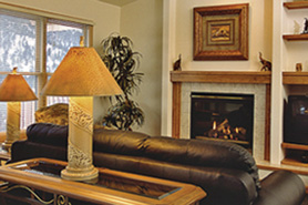 A cozy room with fireplace at Wildwood Inn, The Colorado Vacation Directory