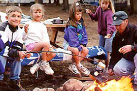Kids around a Campfire at Winding River Resort near Grand Lake, Colorado. Get away to the mountains. Spend time with your family at Winding River.