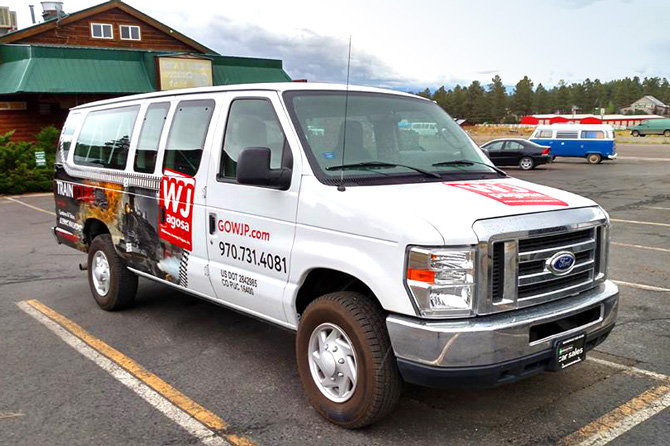 Tour Guide Shuttle Van in parking lot in Pagosa Springs, Colorado